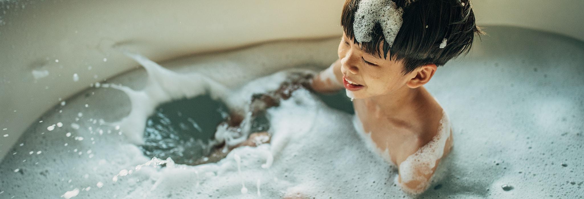 Boy is taking a bath in bathtub
